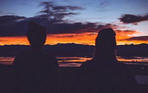 Two people watching a sunset