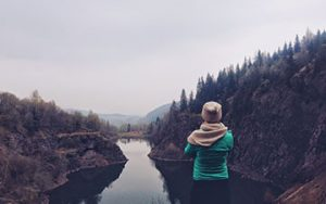 Person looking out over a river
