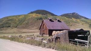 farmhouse with mountains