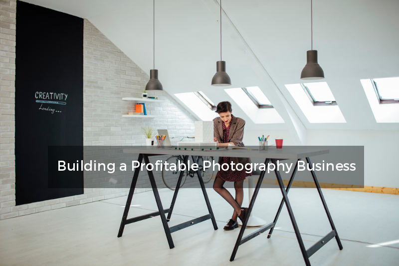 female photographer standing at desk