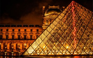 The Louvre art gallery exterior at night