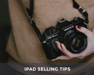photographer with camera and ipad selling tips