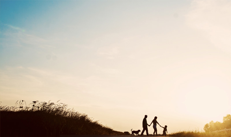 Silhouette of family walking