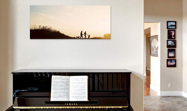 family photo over a piano on the wall