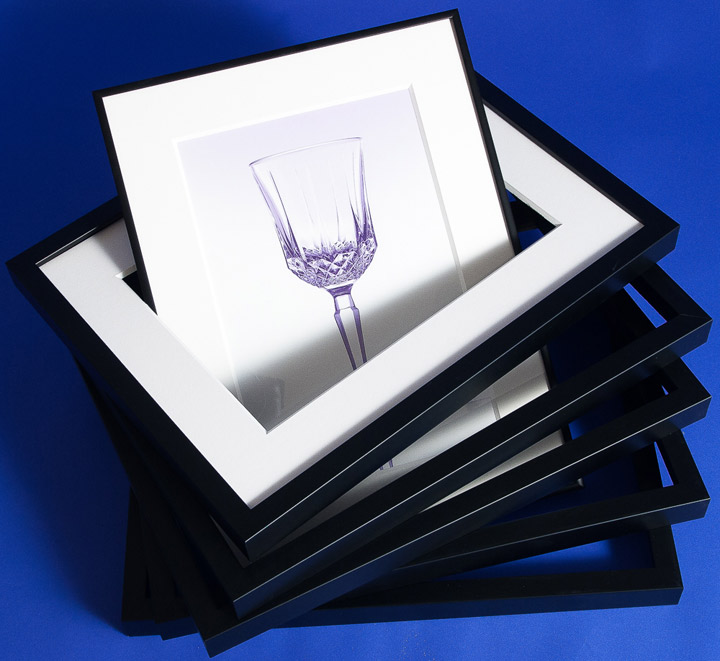stack of similarly sized black frames