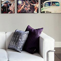 Photography business studio with couch and portraits