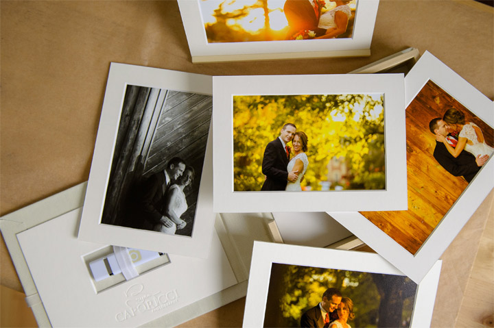 Printed photos lined up on a table